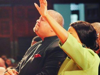 Zanele Mbokazi Nkambule and Bishop Mpendulo Worshiping